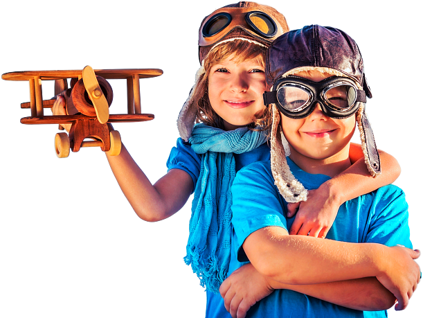 boy and girl standing wearing pilot head gear while girl holding plane